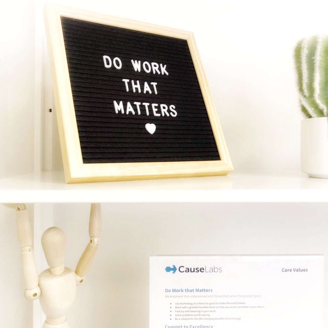"A shelf with a sign that reads, ""Do Work That Matters."""
